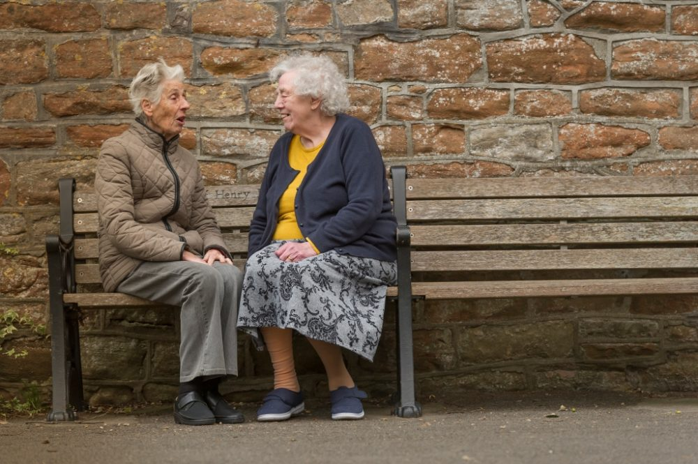 Two ladies on a bench in Bath